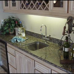 Wet Bar in living area features Kohler sink and faucet.