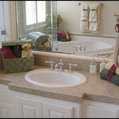 Bathroom features more Kohler fixtures with brushed nickel finish for sink and spa tub.