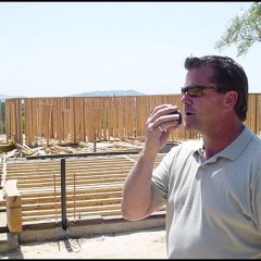 Greg Fleming, Project Manager for Christopherson Homes does much of his supervising with a cell phone.