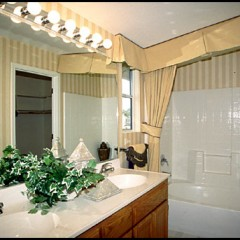 tan bathroom with marble sinks