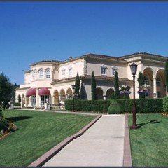 white stucco winery with red canopies