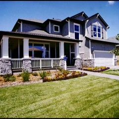 blue gray house with green lawn