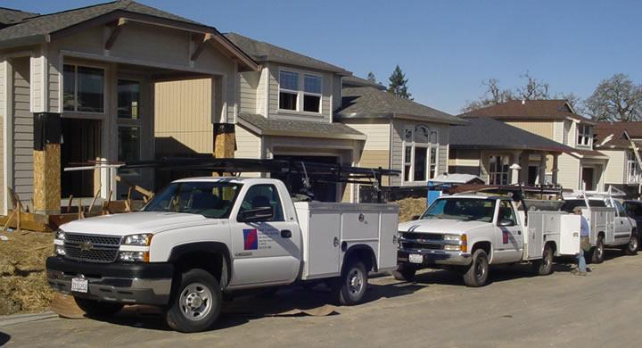 LeDuc & Dexter company vehicles at job site.