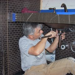 LeDuc & Dexter plumber installing sink