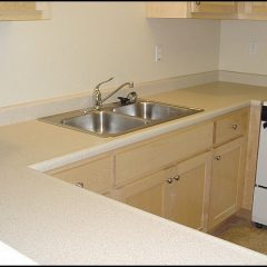 Counter top, sink, and stove in kitchen of HomeAid apartment complex.