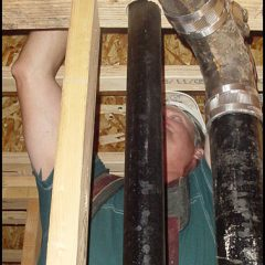 James Dillard installing vent piping.